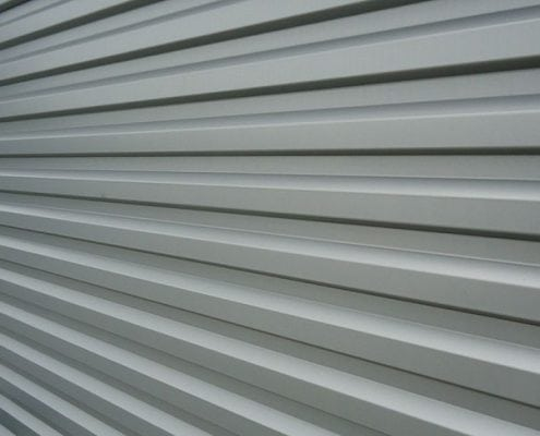 This is a close up image of what aluminum siding looks like. Your New Hampshire or Maine home could have aluminum siding installed by our professional contractors.